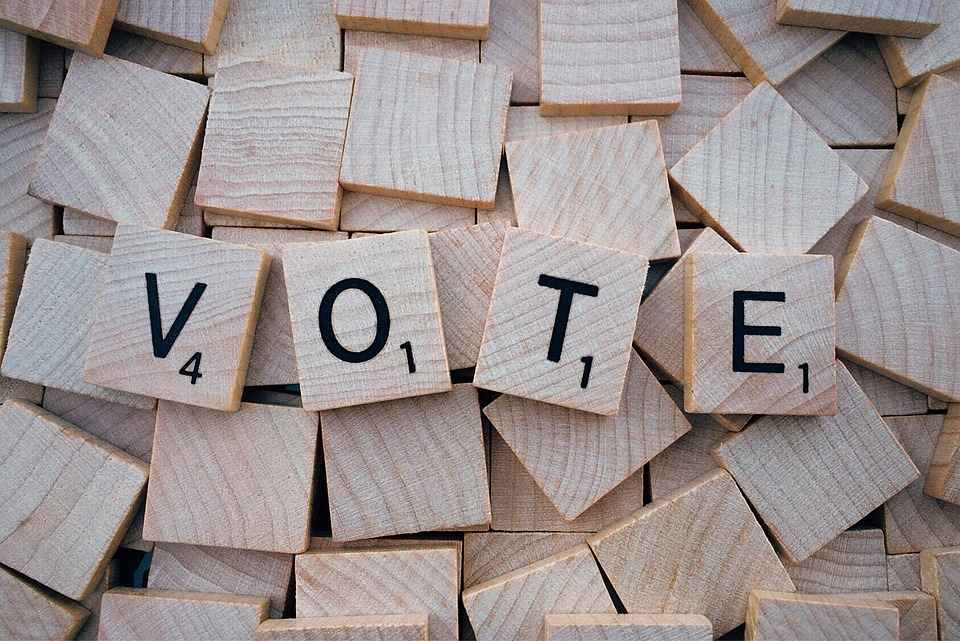 "The word ""Vote"" spelled in scrabble tiles"