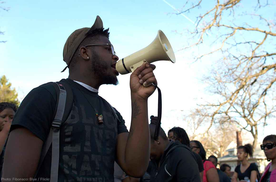 Black man holding a bullhorn at a protest